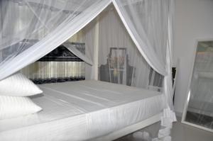 Villa Dineth, Апартаменты  Унаватуна - big - 16