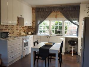 Gardenfly Guesthouse, Apartmány  Somerset West - big - 12