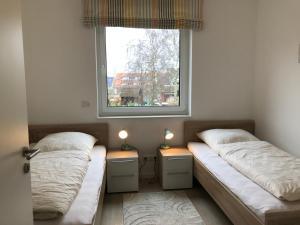 Haus Baltic Cube, Ferienwohnungen  Börgerende-Rethwisch - big - 195