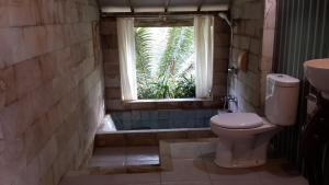 Mi Casa Ijen Guest House, Penzióny  Licin - big - 57