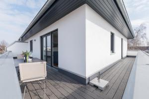 Haus Baltic Cube, Ferienwohnungen  Börgerende-Rethwisch - big - 169