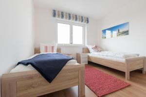 Haus Baltic Cube, Ferienwohnungen  Börgerende-Rethwisch - big - 150