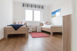 Haus Baltic Cube, Ferienwohnungen  Börgerende-Rethwisch - big - 148
