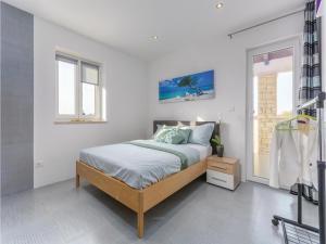 Three-Bedroom Holiday Home in Lovrecica, Prázdninové domy  Lovrečica - big - 5