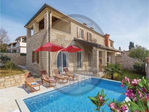 Three-Bedroom Holiday Home in Lovrecica, Prázdninové domy  Lovrečica - big - 1