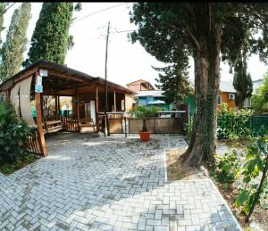 Guesthouse on Kiparisovaya alleya 5, Affittacamere  Pizunda - big - 1