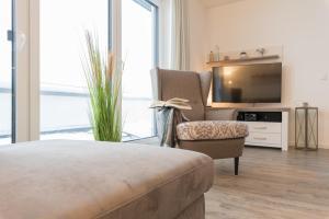 Haus Baltic Cube, Ferienwohnungen  Börgerende-Rethwisch - big - 140