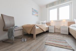 Haus Baltic Cube, Ferienwohnungen  Börgerende-Rethwisch - big - 126