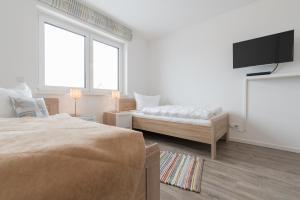 Haus Baltic Cube, Ferienwohnungen  Börgerende-Rethwisch - big - 124