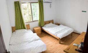 Nanian Zhuzhe International Hostel, Hostely  Jinghong - big - 2