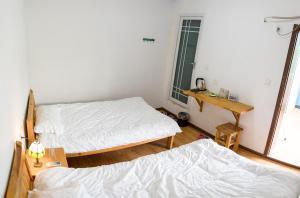 Nanian Zhuzhe International Hostel, Hostely  Jinghong - big - 13