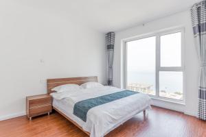 WeiHai Emily Seaview Holiday Apartment International Bathing Beach, Ferienwohnungen  Weihai - big - 37