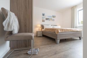 Haus Baltic Cube, Ferienwohnungen  Börgerende-Rethwisch - big - 105