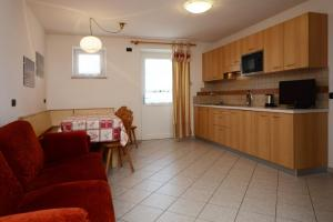 Residence Ciasa Alpe, Apartmanok  Vigo di Fassa - big - 10