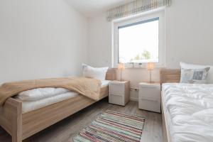 Haus Baltic Cube, Ferienwohnungen  Börgerende-Rethwisch - big - 100