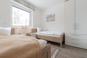 Haus Baltic Cube, Ferienwohnungen  Börgerende-Rethwisch - big - 99