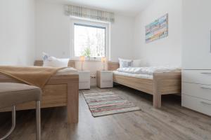 Haus Baltic Cube, Ferienwohnungen  Börgerende-Rethwisch - big - 98