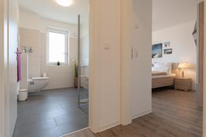 Haus Baltic Cube, Ferienwohnungen  Börgerende-Rethwisch - big - 78