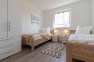 Haus Baltic Cube, Ferienwohnungen  Börgerende-Rethwisch - big - 77