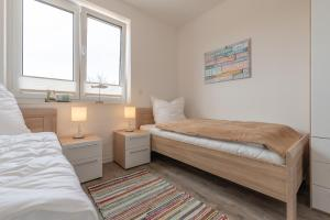 Haus Baltic Cube, Ferienwohnungen  Börgerende-Rethwisch - big - 39