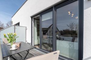 Haus Baltic Cube, Ferienwohnungen  Börgerende-Rethwisch - big - 55