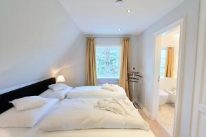 Ulenhof Appartements, Ferienwohnungen  Wenningstedt-Braderup - big - 47