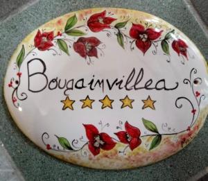 Bougainvillea House a 50 metri dal mare - AbcAlberghi.com
