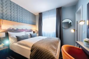 Dvoulůžkový pokoj Economy s manželskou postelí