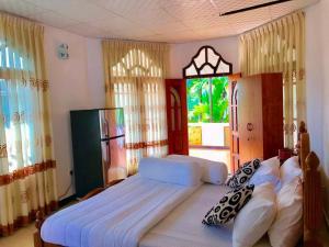 Отель Bentota Dilu Villa, Бентота