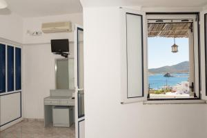 Captain Manos Studio Apartments, Apartments  Grikos - big - 31