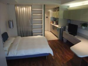 New Oriental Suites in Seasons Park, Апартаменты  Пекин - big - 20