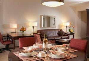 One Bedroom Suite with separate living room, kitchen and dining area.