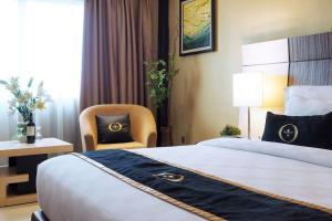 Представительский двухместный номер Делюкс с 1 кроватью или 2 отдельными кроватями