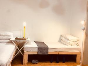 Bed op een Slaapzaal voor Mannen met 4 Bedden