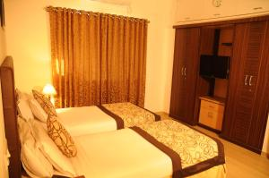 Executive Comfort Guindy, Apartmanok  Csennai - big - 21