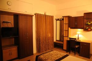 Executive Comfort Guindy, Apartmanok  Csennai - big - 19