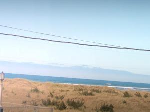 Deluxe Queen Studio with Partial Ocean View #209