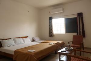 Gokulam Residency, Лоджи  Кумбаконам - big - 18
