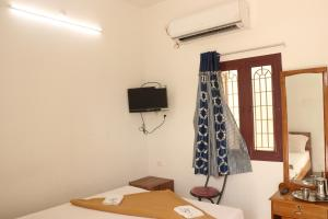 Gokulam Residency, Лоджи  Кумбаконам - big - 16
