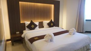 Dvoulůžkový pokoj typu Grand Deluxe s manželskou postelí a výhledem na zahradu