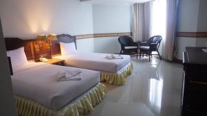 Dvoulůžkový pokoj typu Superior s manželskou postelí nebo oddělenými postelemi a výhledem do zahrady