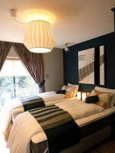 B&B AH87 OSAKA, Bed and breakfasts  Senriyama - big - 13