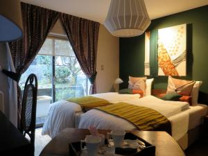 B&B AH87 OSAKA, Bed and breakfasts  Senriyama - big - 11