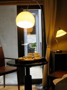 B&B AH87 OSAKA, Bed & Breakfasts  Senriyama - big - 7