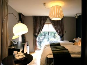 B&B AH87 OSAKA, Bed & Breakfasts  Senriyama - big - 5