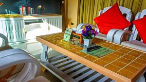Les Palmares Villas, Курортные отели  Банг Тао Бич - big - 119