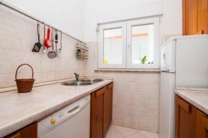 Apartments Cvita Ugljan, Penzióny  Ugljan - big - 21