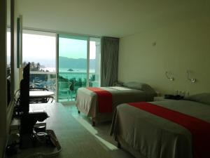 Deluxe Double Room with Two Double Beds - Balcony