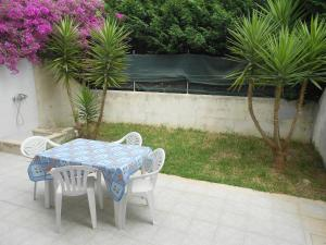 Trilocale con doppio giardino 26, Dovolenkové domy  Torre dell'Orso - big - 13