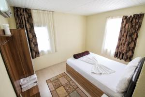 Yellow Rose Pension, Privatzimmer  Canakkale - big - 36